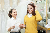 Saleswoman helps bride chooses bridal accessories  — Stock Photo
