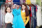 Women chooses evening dress — Stock Photo