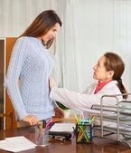Doctor examining the abdomen the girl  — Stock Photo