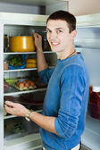 Guy searching for something in refrigerator — Stock Photo