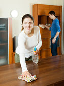 Woman with husband cleaning room — Stock Photo