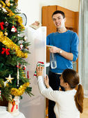 Happy man and woman dusting — Stock Photo