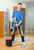 Man washing parquet floor with mop — Foto Stock