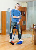 Guy  sweeping the floor — Stock Photo