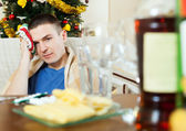 Man having hangover after   New year party — Stock Photo