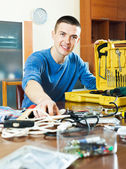 Happy smiling guy showing toolbox — Stock Photo