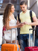 Couple with GPS navigator and baggage — Stock Photo