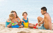 family with children on beach — Stock Photo