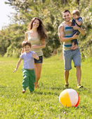 Parents with two children in the park — Stock Photo
