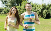 Happy young couple running outdoor  — Stock Photo