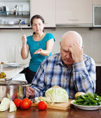 Senior couple after quarrel in kitchen at home  — Stock Photo