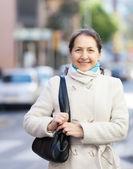 Mature woman in coat — Stock Photo