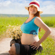 Pregnant woman on summer field — Stock Photo #5717915