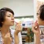 Woman testing the lipstick — Stock Photo #7613329