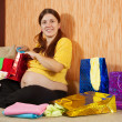 Pregnant woman with purchases — Stock Photo #9890983