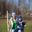 Woman with her son planting tree — Stock Photo #9892342