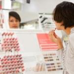 Woman is choosing lipstick — Stock Photo #9904159