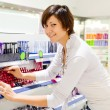 Woman chooses the cosmetic — Stock Photo #9904165