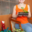 Happy woman with seedlings — Stock Photo #9912407