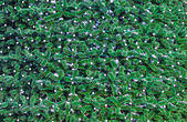 Christmas tree decorated with garland closeup — Stock Photo