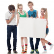 Stock Photo: Four teenagers hold the form