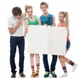 Four teenagers hold the form — Stock Photo