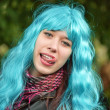 The girl in a wig with piercing in tongue — Stock Photo