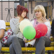 Stock Photo: Friends with balloons
