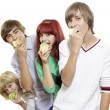 Four teenagers eat green apples — Stock Photo