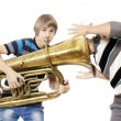 Fun boys enjoy with a trumpet — Stock Photo #13496248