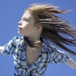 Stock Photo: Portrait of girl with hair flying in wind