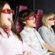 A group of teenagers sits in the 3-D cinema — Stock Photo
