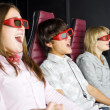 Stock Photo: Group of teenagers sits in 3-D cinema