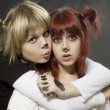 Stock Photo: Two girls with art makeup animal