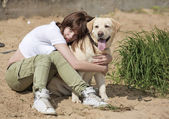 The young woman embraces a dog — Stok fotoğraf