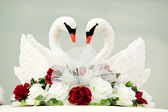 Two white swan as decoration on wedding — Stock Photo