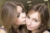 The girl kisses other girl — Stock Photo