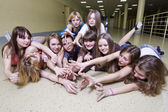 The big group of girls lies on a floor — Stock Photo