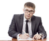 The young man signs the document — Stock Photo