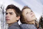 Portrait of the young man and the girl looking every which way — Stock Photo