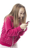 The girl emotionally looks at phone — Stock Photo
