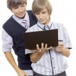 Two boys Holding Laptop — Stock Photo #44266035