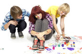 Boy and girls with paint — Stock Photo
