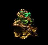 Metal toad with crystals on the black background (souvenir) — Stock Photo