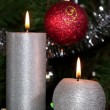 Candle lit in front of festive lights Christmas tree — Stock Video #14510749