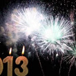 Stock Video: Happy New Year 2013, Candles burn against fireworks, time lapse