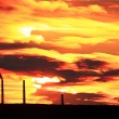 Stock Photo: Factory pipe polluting air at sunset. environmental Problems