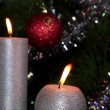 Candle lit in front of festive lights Christmas tree, FULL HD — Video Stock