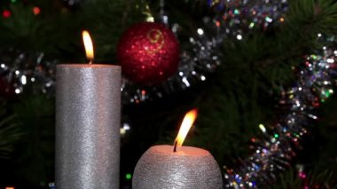 Candle lit in front of festive lights Christmas tree, FULL HD — Wideo stockowe