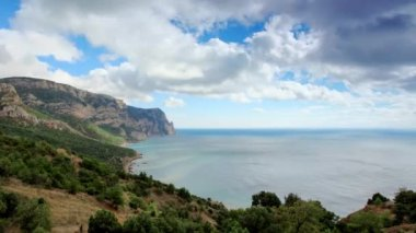 Movement of the clouds on the mountain bay Aya. Crimea, Ukraine (TimeLapse) FULL HD — Stock Video